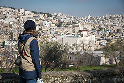 2 March 2020, Hebron: Nora from Finland, a participant in the Ecumenical Accompaniment Programme in Palestine and Israel, looks out over Hebron from a vantage point in the area of Tel Rumeida.