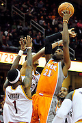 Jan. 19, 2011; Cleveland, OH, USA; Phoenix Suns power forward Hakim Warrick (21) shoots over Cleveland Cavaliers point guard Daniel Gibson (1) and small forward Jamario Moon (15) during the fourth quarter at Quicken Loans Arena. The Suns beat the Cavaliers 106-98. Mandatory Credit: Jason Miller-US PRESSWIRE