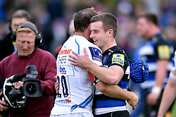George Ford of Bath Rugby embraces former Leicester Tigers team-mate Julian Salvi of Exeter Chiefs after the match - Mandatory byline: Patrick Khachfe/JMP - 07966 386802 - 17/10/2015 - RUGBY UNION - The Recreation Ground - Bath, England - Bath Rugby v Exeter Chiefs - Aviva Premiership.