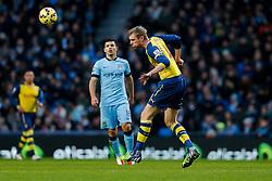 Per Mertesacker of Arsenal heads the ball - Photo mandatory by-line: Rogan Thomson/JMP - 07966 386802 - 18/01/2015 - SPORT - FOOTBALL - Manchester, England - Etihad Stadium - Manchester City v Arsenal - Barclays Premier League.