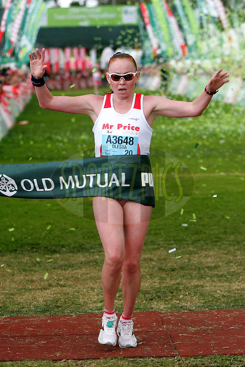 Olesya Nurgalieva of Mr Price celebrates winning the ladies race during the 2010 Old Mutual 2 Oceans Ultra Marathon held in Cape Town, Western Cape, South Africa on the 3 April 2010.Photo by: Ron Gaunt/ SPORTZPICS