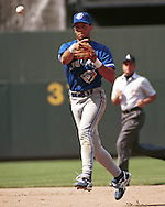 Toronto Blue Jay second basemen Roberto Alomar throws to first base against the Kansas City Royals at Kauffman Stadium in Kansas City, Missouri on June 11, 1995.