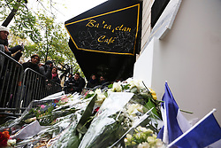 People pay tribute to victims of a terror attack in front of the Bataclan concert Hall in Paris, France, on November 13, 2016, marking the one year anniversary of a series of deadly attacks. Some 130 were killed, 90 of them at Bataclan, when Islamic militants went of the rampage in the heart of the French capital. Photo by Somer/ABACAPRESS.COM