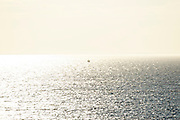 Trawler into the sun, on the horizon. Atlantic Ocean, Bonavista, Newfoundland, Canada.