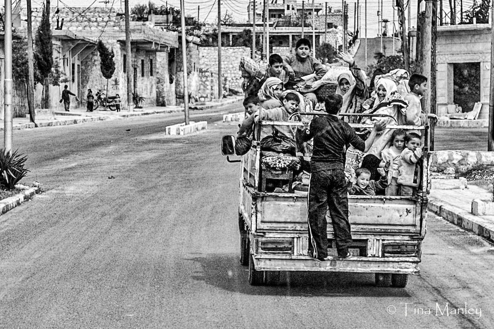 Syrian families going on a picnic with children in truck.