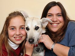 Claudia Smith and her daughter Alyssa (11) re-united with their dog Holly at their home in Andover, Hants, after the family  paid £1,300 to have the dog flown back to Britain after it was found abandoned in Dubai . Stephen Lock / i-Images