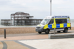 © Licensed to London News Pictures.13/04/2020. Brighton, UK. Police patrol a near empty beach and promenade in Brighton and Hove on Easter Monday as the UK continues to be in the Coronavirus Lockdown. Only a handful of people can be seen outside in the seaside resort on Bank Holiday Monday. Photo credit: Hugo Michiels/LNP