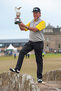 Miguel Angel Jimenez with the trophy on The Swilken Bridge, after winning the Rolex Senior Golf Open at St Andrews, West Sands, Scotland on 29 July 2018. Picture by Malcolm Mackenzie.