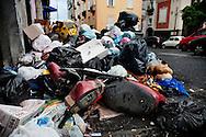 Napoli, Italia - 24 novembre 2010. Un cumulo di spazzatura, tra cui un motorino non raccolta, a via Salvator Rosa nel quartiere Vomero a Napoli. Ph. Roberto Salomone Ag. Controluce.ITALY - Piles of uncollected garbage are seen downtown Naples on November 24, 2010.