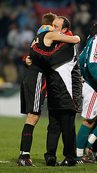 MARSEILLE, FRANCE - Tuesday, December 11, 2007: Liverpool's captain Steven Gerrard MBE embraces manager Rafael Benitez after his side's 4-0 victory over Olympique de Marseille during the final UEFA Champions League Group A match at the Stade Velodrome. The win secures the Reds' place in the knock-out phase of the competition. (Photo by David Rawcliffe/Propaganda)