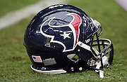 A Houston Texans helmet lies on the grass during pre game warmups before the 2014 NFL preseason football game against the Arizona Cardinals on Saturday, Aug. 9, 2014 in Glendale, Ariz. The Cardinals won the game in a 32-0 shutout. ©Paul Anthony Spinelli