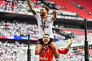 Fulham defender Ryan Fredericks (2)  sits on the shoulders of Fulham goalkeeper Marcus Bettinelli  during the EFL Sky Bet Championship play-off final match between Fulham and Aston Villa at Wembley Stadium, London, England on 26 May 2018. Picture by Dennis Goodwin.