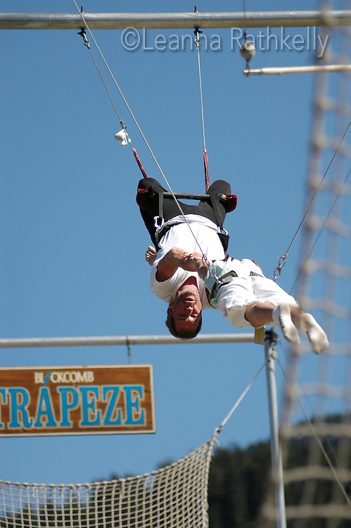 Girl 10-12 enjoys a trapeze ride at the Blackcomb Adventure Zone, Whistler, BC