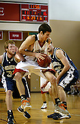 John Grotberg '10 struggles through two Lawrence defenders during the Midwest Conference Championship game at Darby Gymnasium.