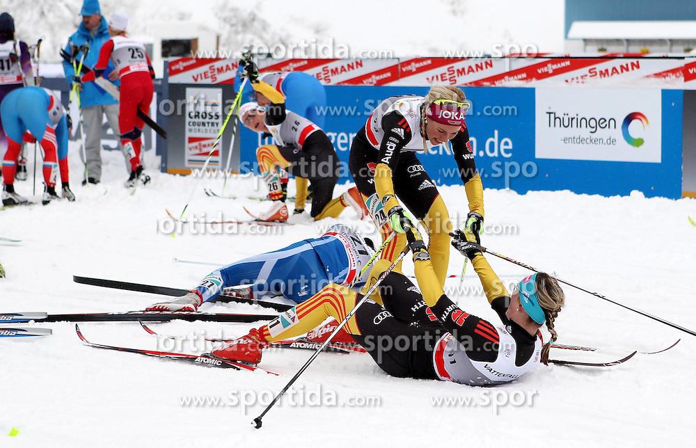 31.12.2011, DKB-Ski-ARENA, Oberhof, GER, Viessmann Tour de Ski 2011, FIS Langlauf Weltcup, Verfolgung Damen, im Bild Stefanie Boehler (GER) hilft Denise Herrmann (GER) im Ziel auf die Beine // during pursuit Women of Viessmann Tour de Ski 2011 FIS World Cup Cross Country at DKB-SKI-Arena Oberhof, Germany on 2011/12/31. EXPA Pictures © 2011, PhotoCredit: EXPA/ nph/ Hessland..***** ATTENTION - OUT OF GER, CRO *****
