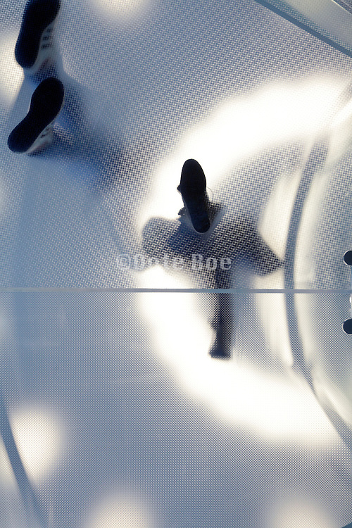 frosted glass plate with people standing on it seen from under, Apple store Leidseplein Amsterdam