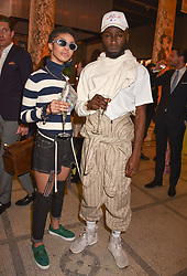 Kojey Radical and guest at Fashioned From Nature held at The V&A Museum, London, England. 18 April 2018.