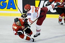 Tomasz Proszkiewicz of Poland with big hit on Csaba Kovacs of Hungary at IIHF Ice-hockey World Championships Division I Group B match between National teams of Hungary and Poland, on April 18, 2010, in Tivoli hall, Ljubljana, Slovenia. Hungary defeated Poland 6-0. (Photo by Matic Klansek Velej / Sportida)