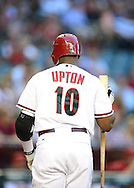May. 7, 2012; Phoenix, AZ, USA; Arizona Diamondbacks outfielder Justin Upton (10) during the game against the St. Louis Cardinals at Chase Field.  The Cardinals defeated the Diamondbacks 9-6. Mandatory Credit: Jennifer Stewart-US PRESSWIRE.