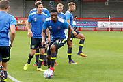 Carlisle United Midfielder Kelvin Etuhu (21) warms up before kick off during the EFL Sky Bet League 2 match between Crawley Town and Carlisle United at the Checkatrade.com Stadium, Crawley, England on 30 September 2017. Photo by Andy Walter.