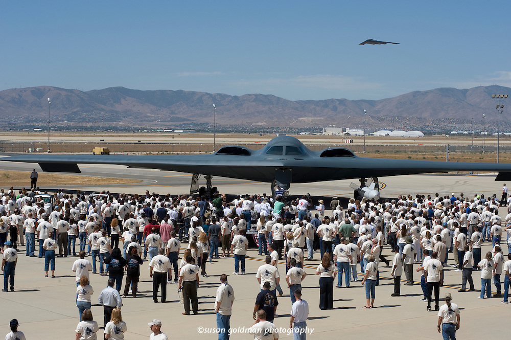 A B-2 Spirit stealth bomber flies over Northrop Grumman's 20th anniversary celebration of the first flight of the B-2 in Palmdale, Calif. The first B-2, a tailless, bat-like flying wing named the Spirit of America, lifted off from Palmdale on July 17, 2009. Photo/Northrop Grumman Corp., Susan Goldman.