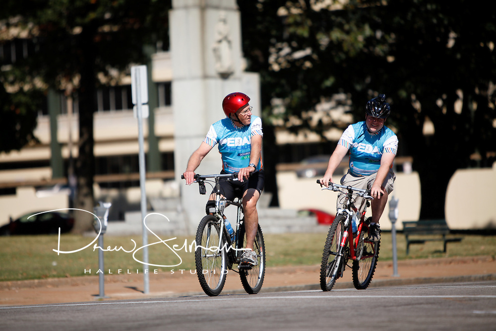 9-OCT-2010 -- ST LOUIS - Riders cross the finish line in front of Soldier's Memorial in downtown St. Louis in Saturday's inaugural Pedal the Cause bicycle ride.  Over 700 people participated and the ride raised in excess a reported $1million for cancer research in St. Louis.  Pedal the Cause was founded as an annual cycling event that seeks to provide and direct net funding for cancer research, cancer discovery grants and clinical translational care on best ideas not currently eligible for federal funds.  With 100% of donations remaining in St. Louis, the event was started by Bill Koman, a St Louis business man and himself a cancer survivor.