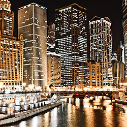 Chicago city skyline at night along the Chicago River buildings at night with Wabash Avenue Bridge (Irv Kupcinet Bridge) with the London Guarantee Building (360 North Michigan Avenue), Unitrin / Kemper Building (1 East Wacker Drive), Renaissance Hotel (1 West Wacker Drive), Leo Burnett Building (35 West Wacker Drive), 55 West Wacker Drive, United Airlines Building (77 West Wacker Drive), Waterview Tower (111 West Wacker Drive), and Trump International Hotel and Tower (401 North Wabash Avenue).