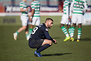 17th March 2019, Dens Park, Dundee, Scotland; Ladbrokes Premiership football, Dundee versus Celtic; James Horsfield of Dundee dejected at the end of the match