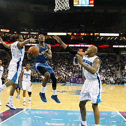 February 1, 2011; New Orleans, LA, USA; Washington Wizards point guard John Wall (2) shoots between New Orleans Hornets guard Marcus Thornton (5) and power forward David West (30) during the second quarter at the New Orleans Arena.   Mandatory Credit: Derick E. Hingle