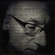 Self portrait using a texture overlay with writing and birds...