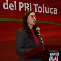 Toluca, Mexico.- Tania Hurtado Parra, presidenta del Comite municipal durante la conferencia de Jaime Vázquez Castillo, ex presidente del PRI estatal quien dicto la conferencia magistral con motivo del aniversario de este partido ante la presencia de priistas toluqueños. Agencia MVT / José Hernández