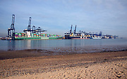 Container ships and cranes in the Port of Felistowe, Britain's busiest container port, pictured from across the River Orwell at Shotley, Sufolk, England