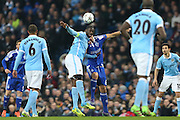 Yaya Touré of Manchester City and Aleksandar Dragović of Dynamo Kyiv challenge for a high ball during the Champions League round of 16 match between Manchester City and Dynamo Kiev at the Etihad Stadium, Manchester, England on 15 March 2016. Photo by Simon Brady.