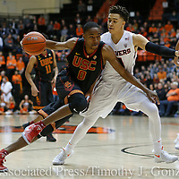 USC's Shaqquan Aaron, left, tries to get past Oregon State's JaQuori McLaughlin in the first half of an NCAA college basketball game in Corvallis, Ore., Wednesday Dec. 28, 2016. (AP Photo/Timothy J. Gonzalez)