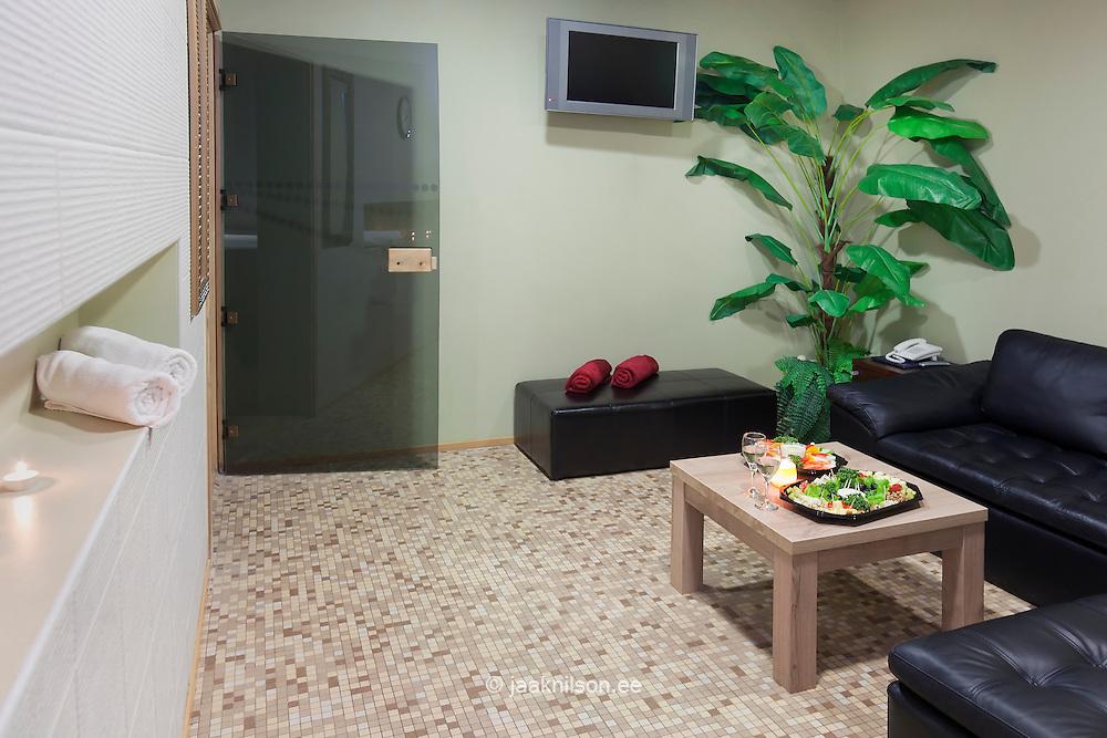 Sofa, chairs and food on table in sauna suite. Viimsi Spa Hotel, Tallinn, Estonia.