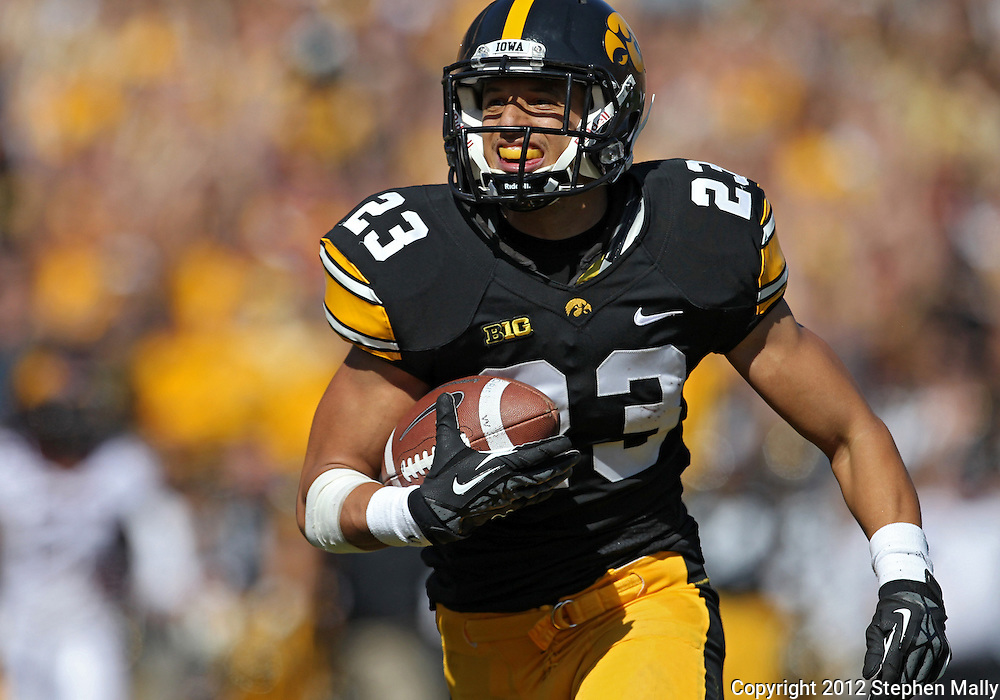 September 29 2012: Iowa Hawkeyes wide receiver Jordan Cotton (23) runs 47 yards for a touchdown after a catch during the second quarter of the NCAA football game between the Minnesota Golden Gophers and the Iowa Hawkeyes at Kinnick Stadium in Iowa City, Iowa on Saturday September 29, 2012. Iowa defeated Minnesota 31-13 to claim the Floyd of Rosedale Trophy.
