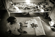 A small malnutritioned boy lying on the floor in the hospital in Bangui. Due to high amount of sick children, many children have to either sleep outside with their parents or share a bed with up to four other children. The central African rep. has some of the world's worst child welfare indicators. The infant mortality rate is 112, and out of 1,000 children born in CAR, 171 will die before reaching the age of five. The five main child killers in CAR are malaria, diarrhoea, acute respiratory infections, malnutrition and measles – all preventable diseases. The Accelerated Child Survival and Development Strategy UNICEF is implementing aims to reach every newborn and child in every district with a set of priority interventions. Evidence shows that there are a number of known and affordable interventions that if implemented fully could prevent 63 per cent of current childhood mortality.