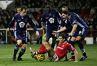 Photo: Paul Thomas.<br /> Nottingham Forest v Leyton Orient. Coca Cola League 1. 16/12/2006.<br /> <br /> Nicky Southall (Ground) of Forest tries to win the ball surrounded by Orient players.