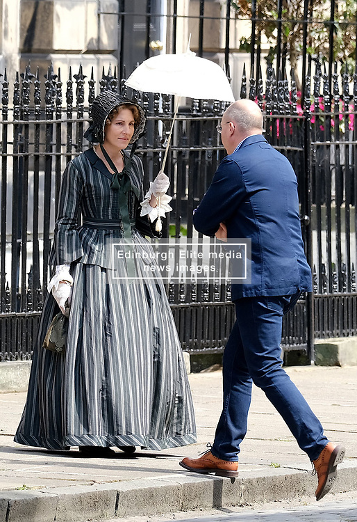 "Moray Place in Edinburgh's Georgian old town was turned into 19th century London for Julian Fellowes' new ITV show ""Belgravia"".<br /> <br /> Pictured: Tamsin Greig (striped dress) between takes<br /> <br /> Alex Todd 