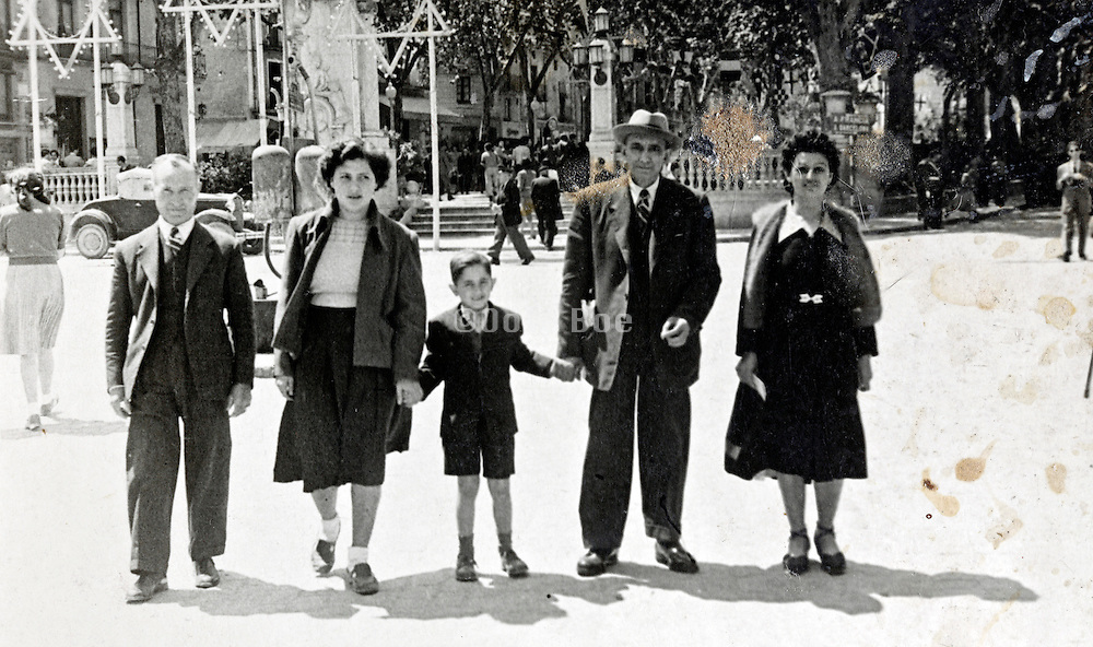 family walking with David stars decoration in the background France 1930s