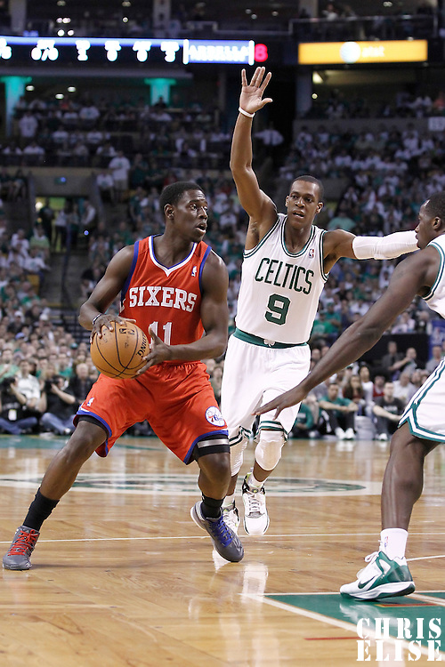 26 May 2012: Philadelphia Sixers point guard Jrue Holiday (11) looks to pass the ball as Boston Celtics point guard Rajon Rondo (9) and Boston Celtics power forward Brandon Bass (30) defend during the Boston Celtics 85-75 victory over the Philadelphia Sixer, in Game 7 of the Eastern Conference semifinals playoff series, at the TD Banknorth Garden, Boston, Massachusetts, USA.