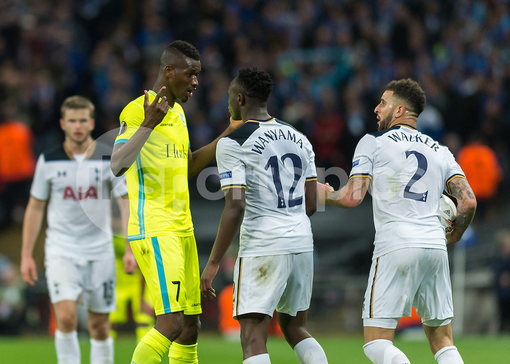 Kalifa Coulibaly of KAA Gent and Victor Wanyama of Tottenham Hotspur square up during the UEFA Europa League  Round of 32 Game 2 match between Tottenham Hotspur and Gent at Wembley Stadium, London, England on 23 February 2017. Photo by Vince  Mignott.