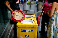 An ice cream vender sells coconut and chocolate ice creams, in San Juan, Puerto Rico, on Friday, November 14, 2008.