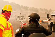 "03 JUNE 2011 - SPRINGERVILLE, AZ: Mike Taylor (CQ) from ADoT, talks to Ron Grittman, (CQ) from Chino Valley, at a roadblock on Highway 180 at Nelson Reservoir. The road into Nutrioso and Alpine is closed from here to south of Hannigan's Meadow. Grittman was planning on riding his Harley from Chino Valley down 180 to Lordsburg NM and Silver City and back. Now he's looking for a new route. High winds and temperatures have continued to complicate firefighters' efforts to get the Wallow fire under control. The  mandatory evacuation order for Alpine was extended to Nutrioso, about 10 miles north of Alpine and early Friday morning fire was reported on the south side of Nutrioso. The fire grew to more than 106,000 acres early Friday with zero containment. A ""Type I"" incident command team has been called in to manage the fire.  PHOTO BY JACK KURTZ"