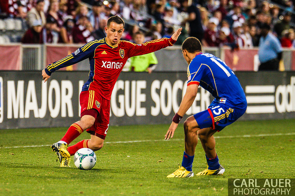 April 6th, 2013 - Real Salt Lake midfielder Luis Gil (21) attempts to get past Colorado Rapids defender Chris Klute (15) in second half action of the MLS match between Real Salt Lake and the Colorado Rapids at Dick's Sporting Goods Park in Commerce City, CO