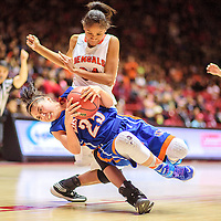 031215  Adron Gardner/Independent<br /> <br /> Los Lunas Tiger Daisia Martinez (25) twirls around Gallup Bengal Ni'asia McIntosh (34) after a jump ball tie up during a 5A New Mexico state basketball tournament final at The Pit in Albuquerque Thursday.