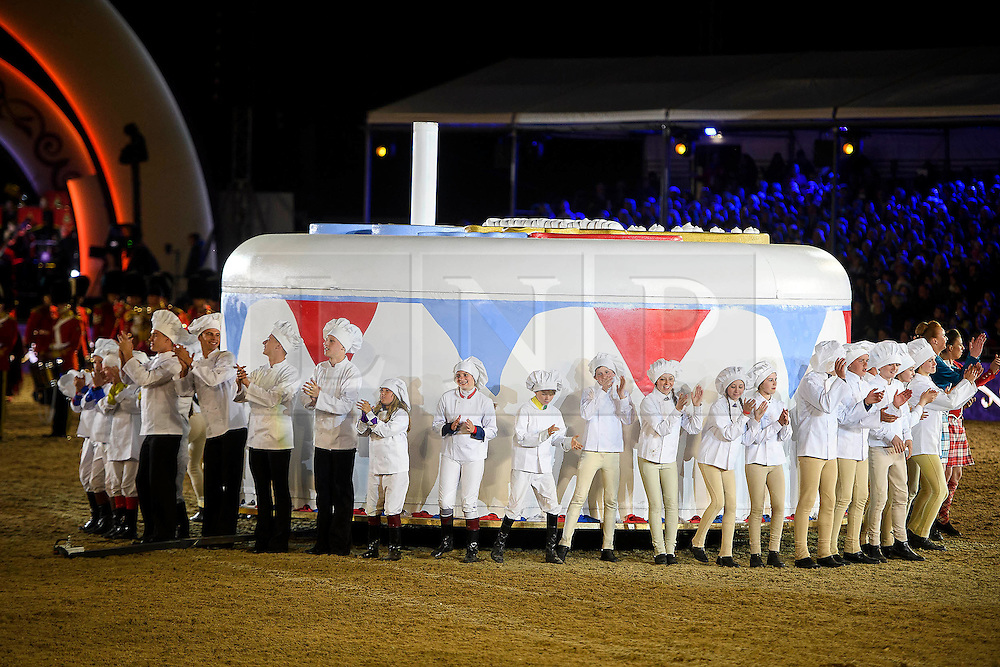 © Licensed to London News Pictures. 15/05/2016. Windsor, UK. A giant cake in the arena at the end of the performance.  An evening event held at the Royal Windsor Horse show to celebrate the 90th birthday of HRH Queen Elizabeth II. Acts from arounds the world have been invited to perform at the evening event, set in the grounds of Windsor Castle. Photo credit: Ben Cawthra/LNP