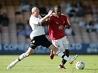 Photo: Paul Thomas.<br /> Port Vale v Bristol City. Coca Cola League 1. 23/09/2006.<br /> <br /> Jennison Williams (R) of Bristol goes past the tackle of Danny Whitaker.