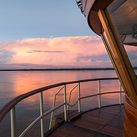 View of the sunset from the bow of the Delfin II ship on the Marañon River. Pacaya Samiria National Reserve, Upper Amazon, Peru.