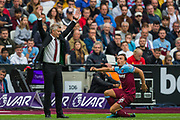 Ole Gunnar Solskjaer, Manager of Manchester United throws his arms in the air with Mark Noble (Capt) (West Ham) getting up from the ground to his side during the Premier League match between West Ham United and Manchester United at the London Stadium, London, England on 22 September 2019.